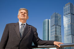 Senior man near skyscrapers construction Stock Photo