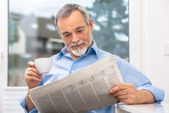Senior man with newspaper Stock Photo