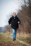 Senior man nordic walking Stock Images