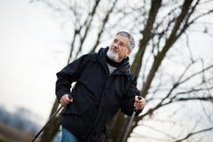 Senior man nordic walking, Stock Photography
