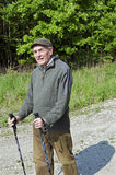 The senior man by nordic walking Royalty Free Stock Photo