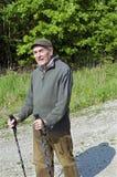 The senior man by nordic walking Royalty Free Stock Photo