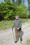 The senior man by nordic walking Stock Images