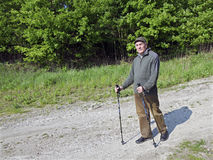 The senior man by nordic walking Royalty Free Stock Photos