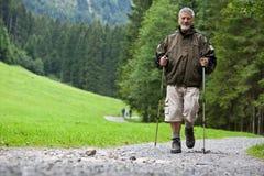 Senior man nordic walking outdoors Stock Photo