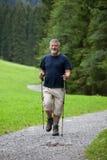 Senior man nordic walking outdoors Stock Photos