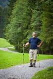 Senior man nordic walking outdoors Royalty Free Stock Photography