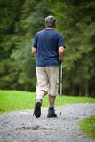 Senior man nordic walking outdoors Royalty Free Stock Images