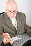 Senior man with notebook learning computer Stock Photography