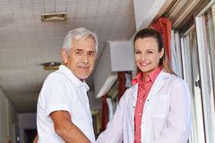 Senior man with nurse in hospital Royalty Free Stock Image