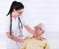 Senior man with nurse Stock Images