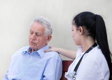 Senior man with nurse Royalty Free Stock Images
