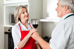 Senior man offering wife wine Stock Images
