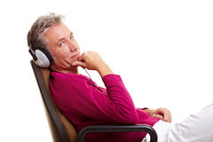 Senior man in office chair Stock Images