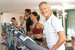 Senior Man On Running Machine Royalty Free Stock Photos