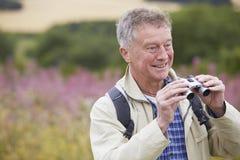 Senior Man On Walk With Binoculars Royalty Free Stock Image