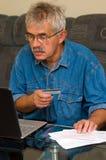 Senior man online shopping Royalty Free Stock Photo