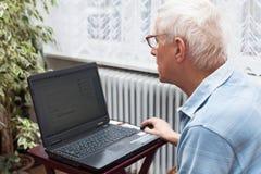 Senior man online Stock Images