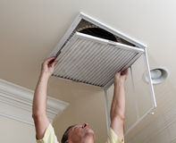 Senior man opening air conditioning stock images
