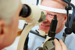 Senior man at optician looking Royalty Free Stock Photo