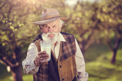 Senior man in orchard Royalty Free Stock Image