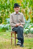 Senior man outdoor. Portrait of a wrinkled and expressive old farmer outdoor Royalty Free Stock Photo