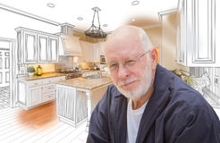 Senior Man Over Custom Kitchen Design Drawing and Photo Stock Photo