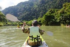 Senior man paddling. Kayak at river stock photo