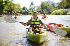 Senior man paddling kayak Stock Photo