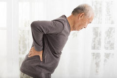 Senior man with Pain in back Stock Image