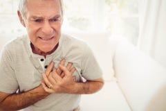 Senior man with pain on heart Stock Photo