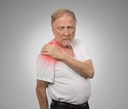 Senior man with pain in his shoulder royalty free stock images