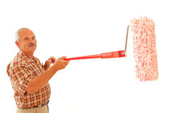 Senior man with paint roller Royalty Free Stock Images