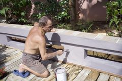 Senior man painting Stock Images