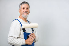 Senior man painting a wall in his home Royalty Free Stock Photos