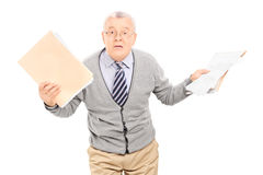 Senior man panicking with papers in his hand Stock Photos