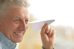 Senior man with paper plane Royalty Free Stock Photography