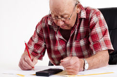 Senior man and paper work Stock Images