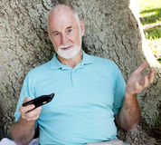 Senior Man in Park With Computer Stock Photos