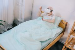 Senior man patient in clinical bed using. Vr headset Stock Photography