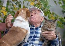 Senior man with pets royalty free stock image