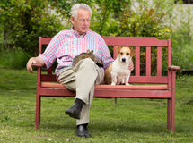 Senior man with pets Royalty Free Stock Photos
