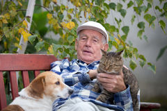 Senior man with pets stock images