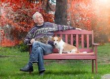Senior man with pets Stock Image