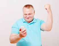 Senior man with phone and hand up Stock Image