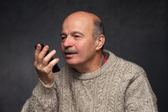 Senior man with phone. Happy face of old guy. Stock Images