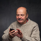 Senior man with phone. Happy face of old guy. Royalty Free Stock Images