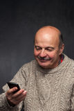 Senior man with phone. Happy face of old guy. Royalty Free Stock Photo