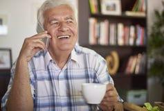 Senior man on the phone. Senior man talking on his mobile phone Royalty Free Stock Images