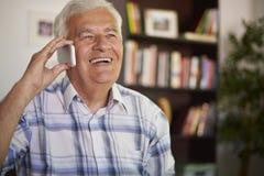 Senior man on the phone Royalty Free Stock Photos